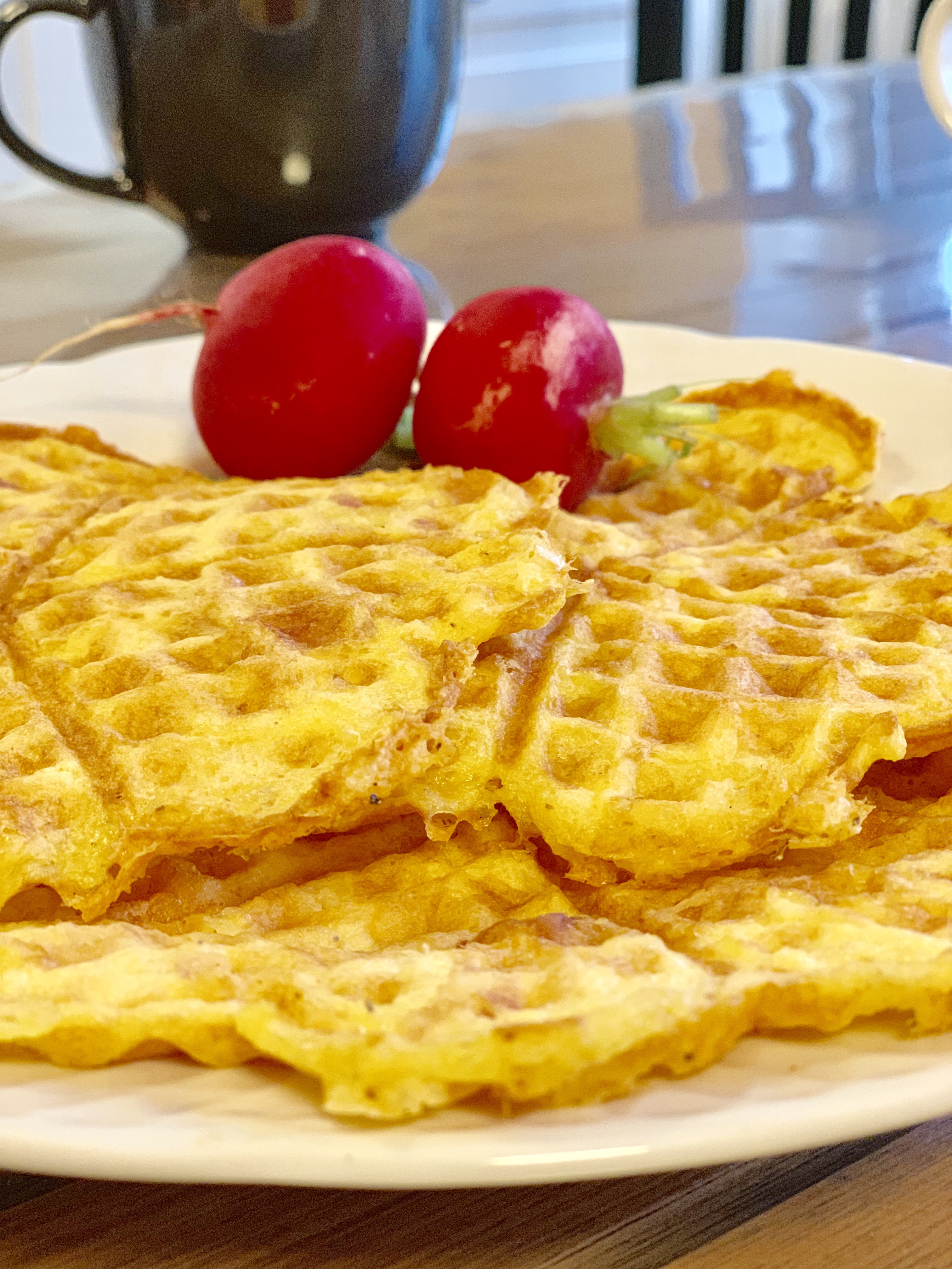 Photo of savory keto waffles with cheese and chicken and ham