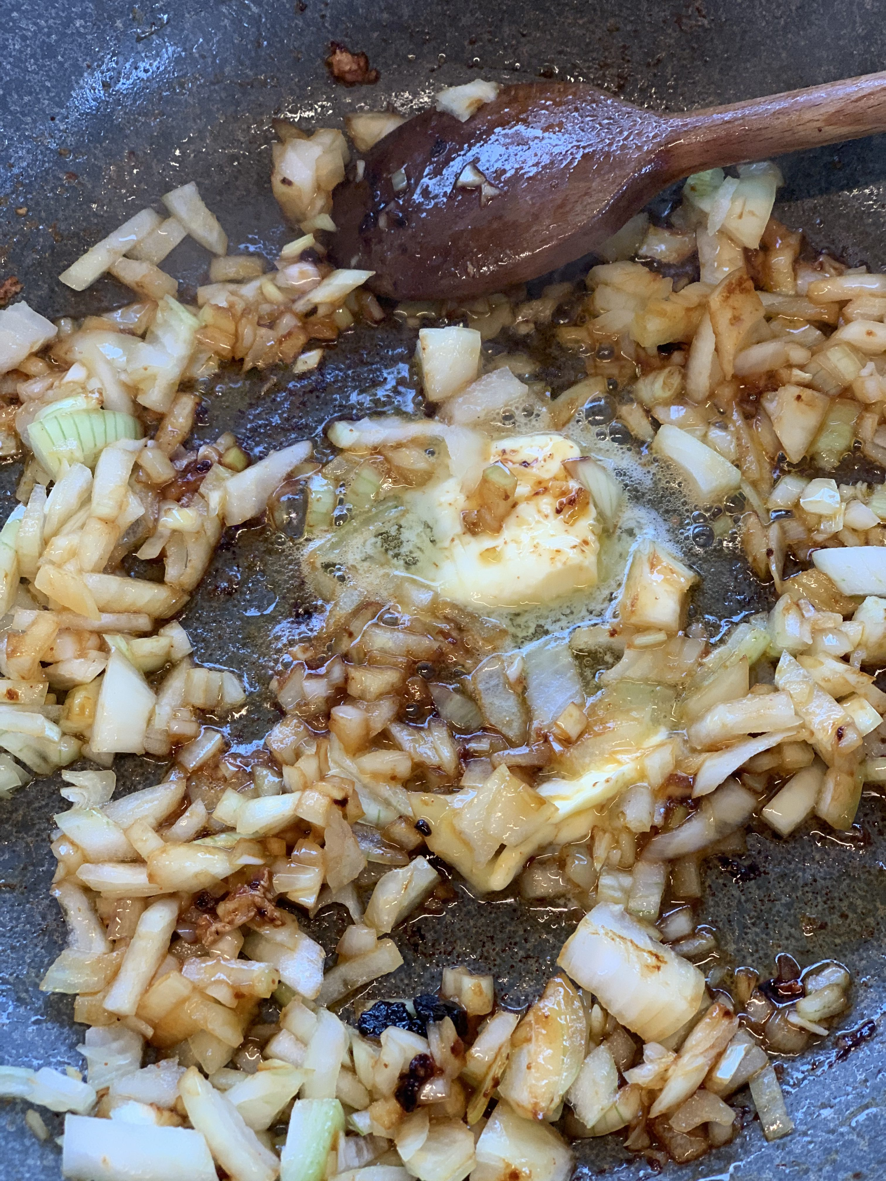 Picture of onion and butter on the stove