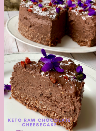 Picture of keto raw chocolate cake with violets on top