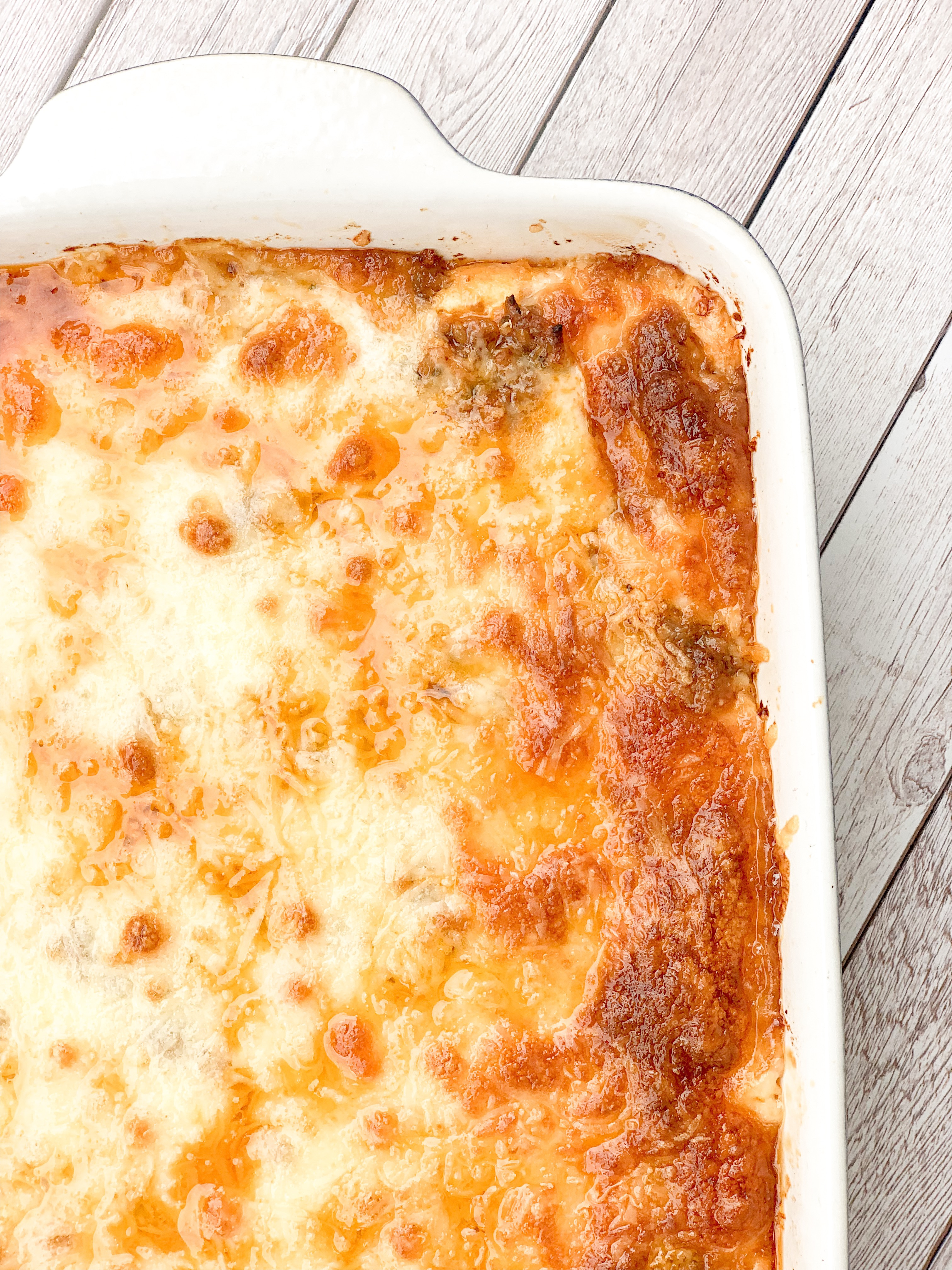 Picture of baked keto lasagna with golden brown top of melted baked cheese