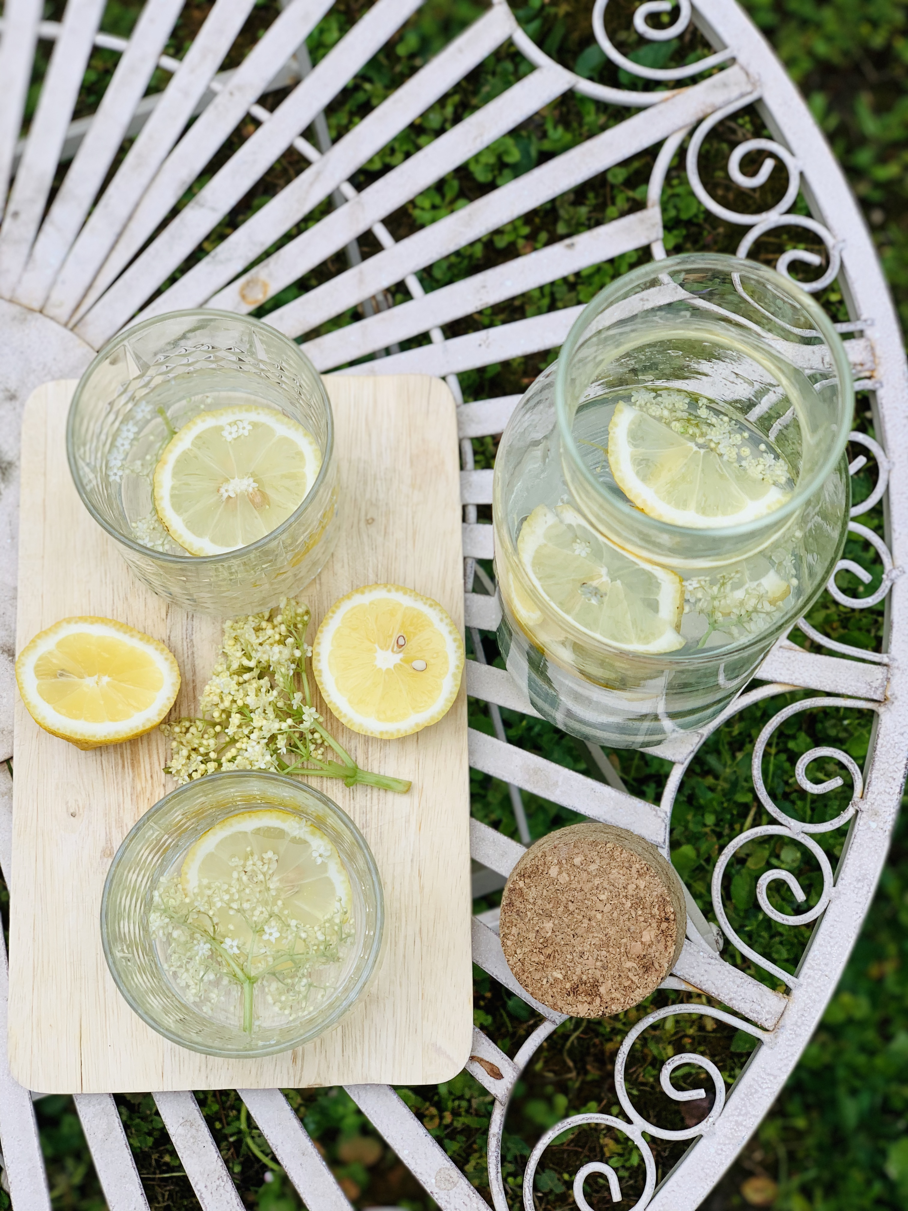 Picture of elderflower syrup drink on the garden table