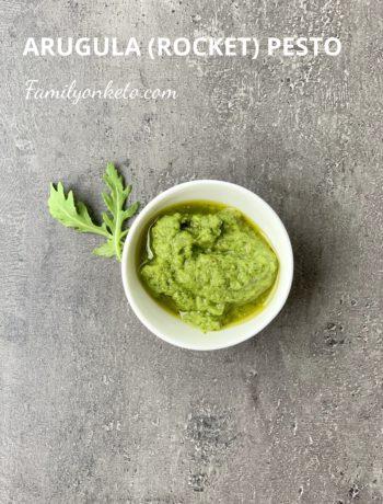 Picture of keto arugula pesto o a grey table