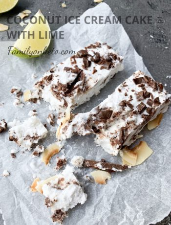 Picture of keto coconut ice cream cake bars on the table wit lime slices