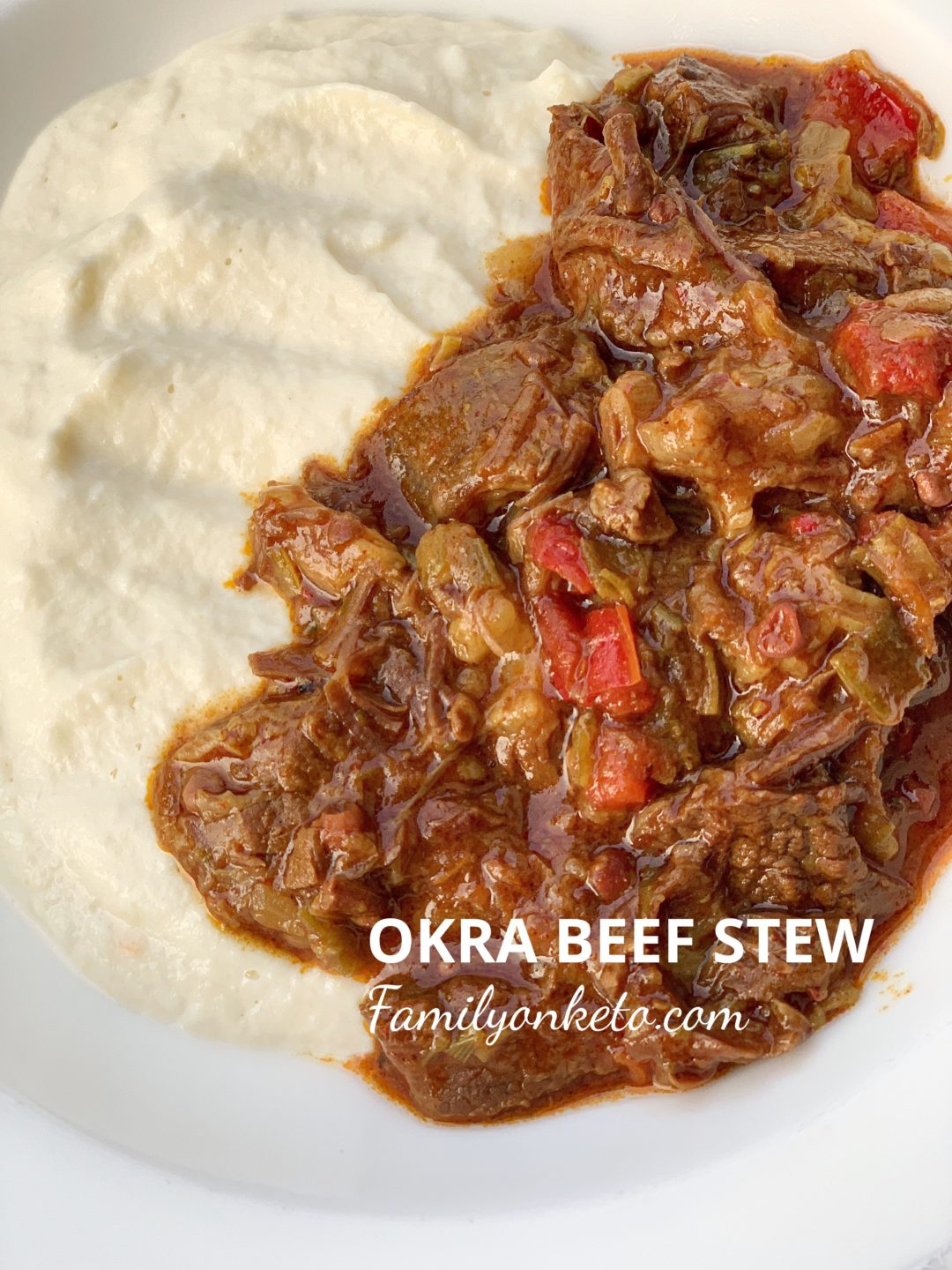 Picture of a plate full of okra beef stew with cauliflower mash