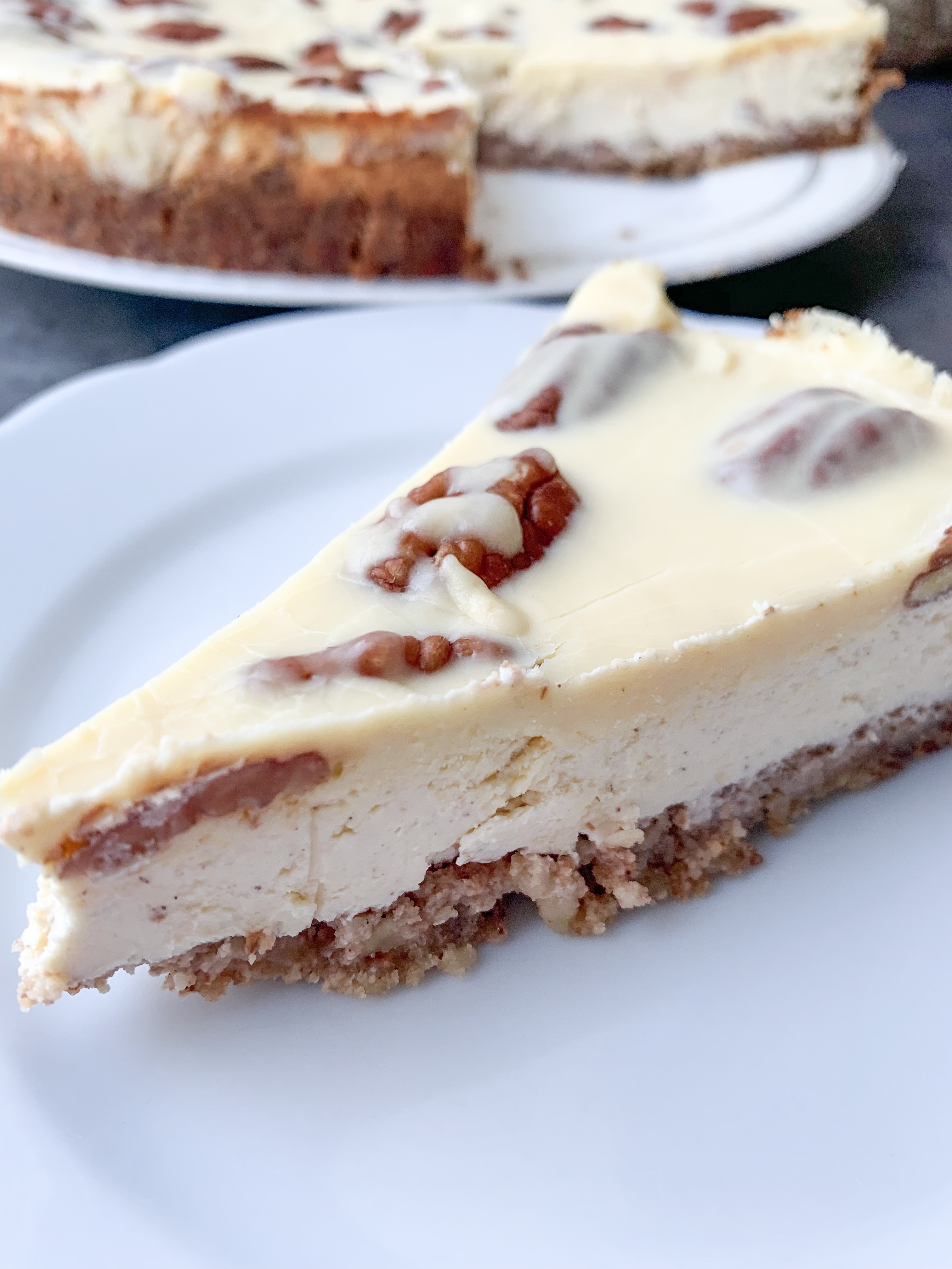 Picture of a slice of low carb pecan pie cheesecake with keto caramel topping with erythritol
