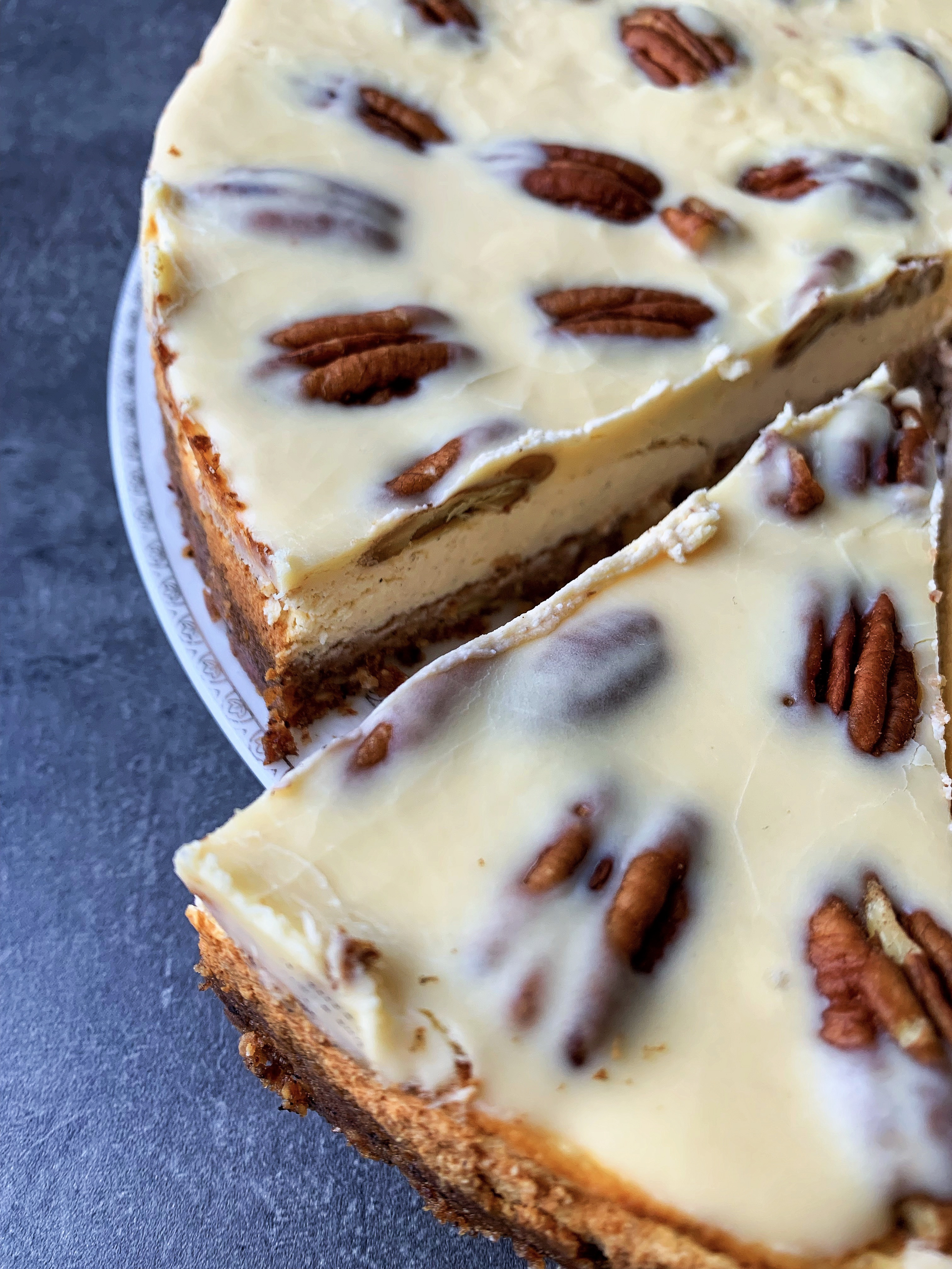 Photo of low carb pecan pie cheesecake with keto caramel topping with erythritol