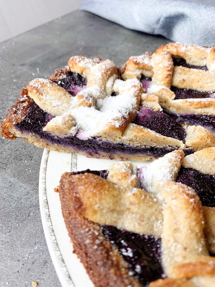 Picture of a gluten free and sugar free keto Linzer cake with blueberry jam