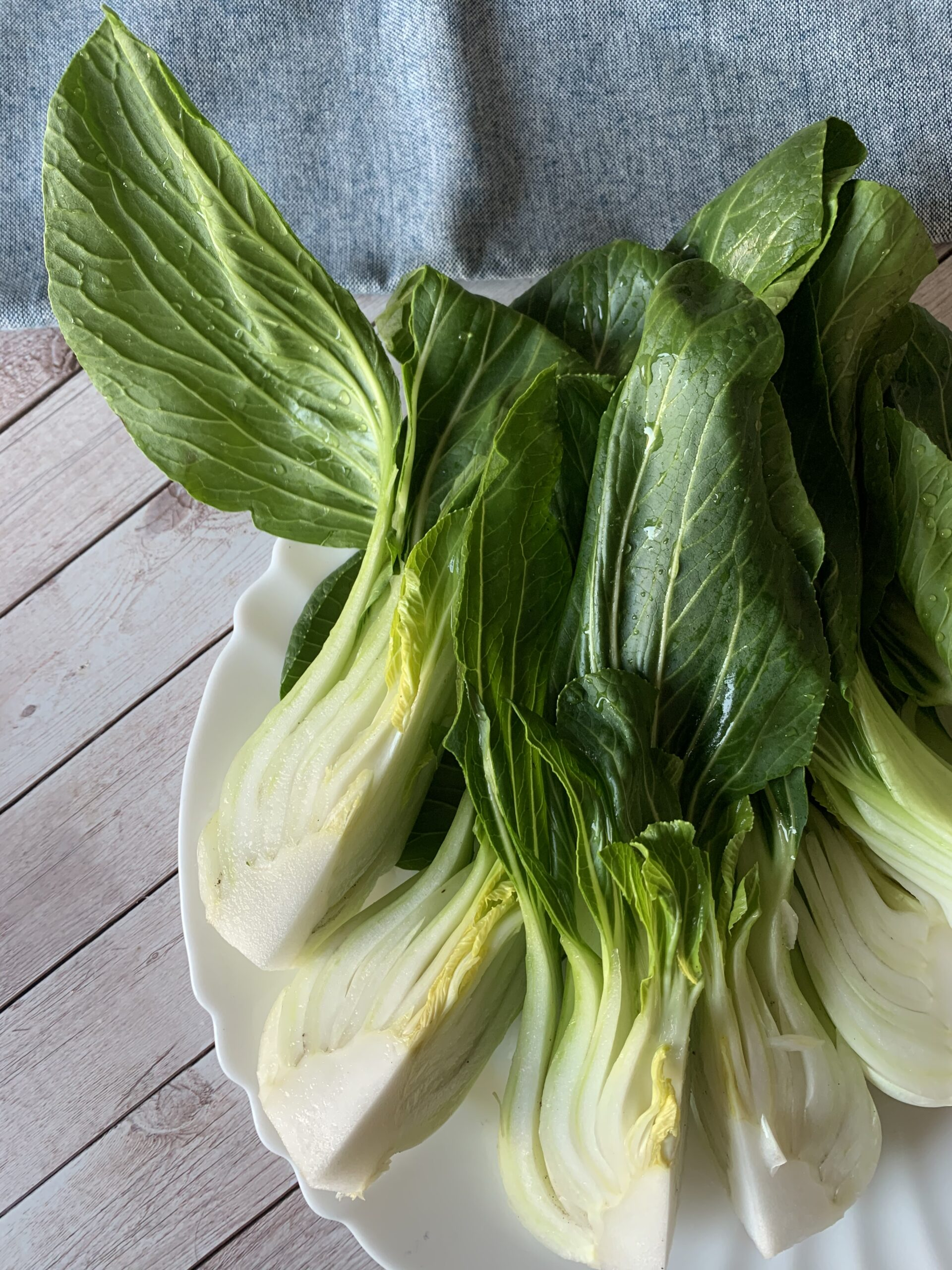 Pak choi or bok choy cut on a plate