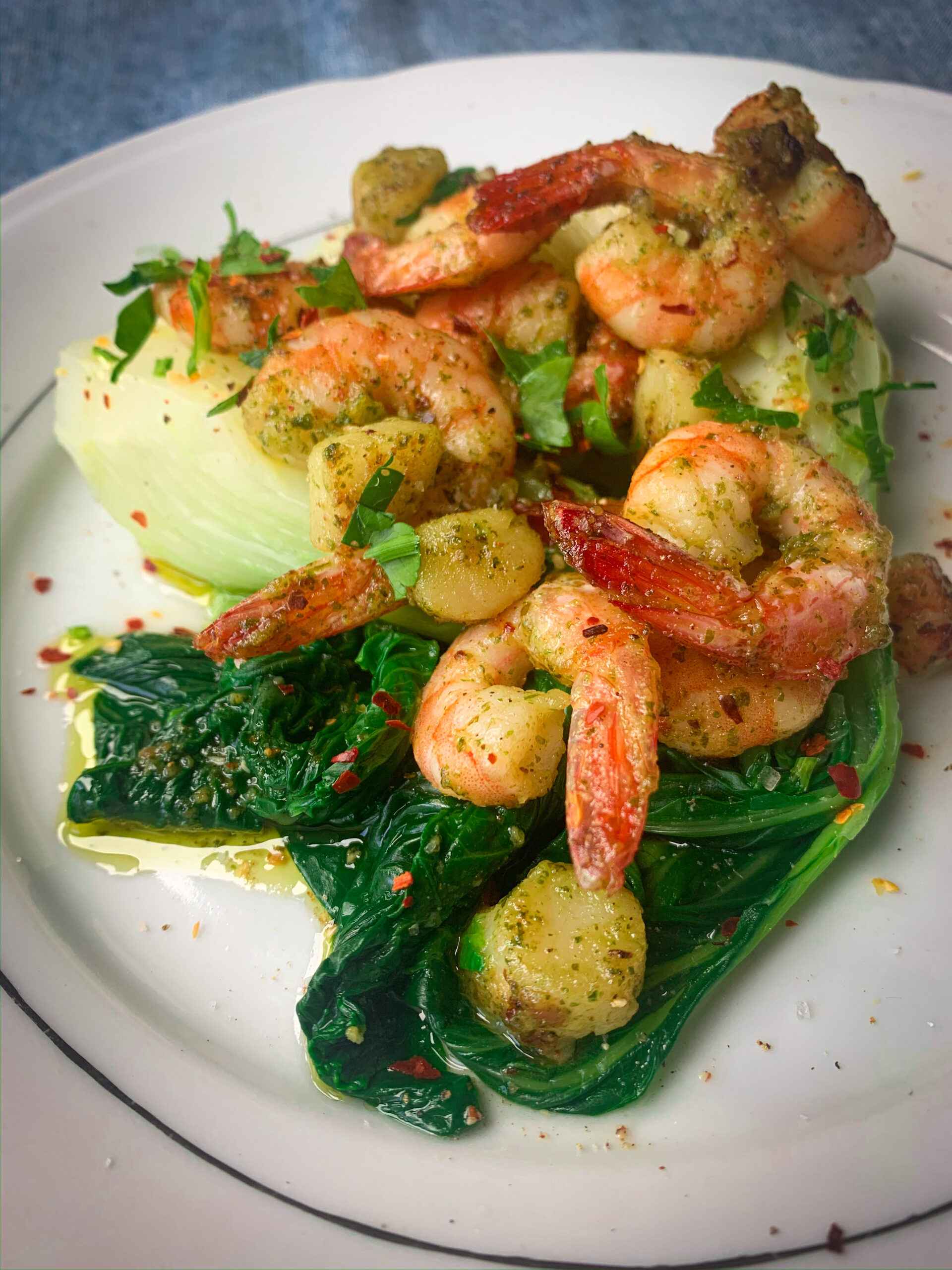 Picture of a plate full of bok choy with sauteed shrimps and scallops and chilli