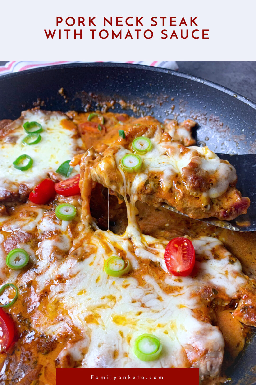 Pork neck steak with tomato sauce with melted mozzarella cooked in skillet