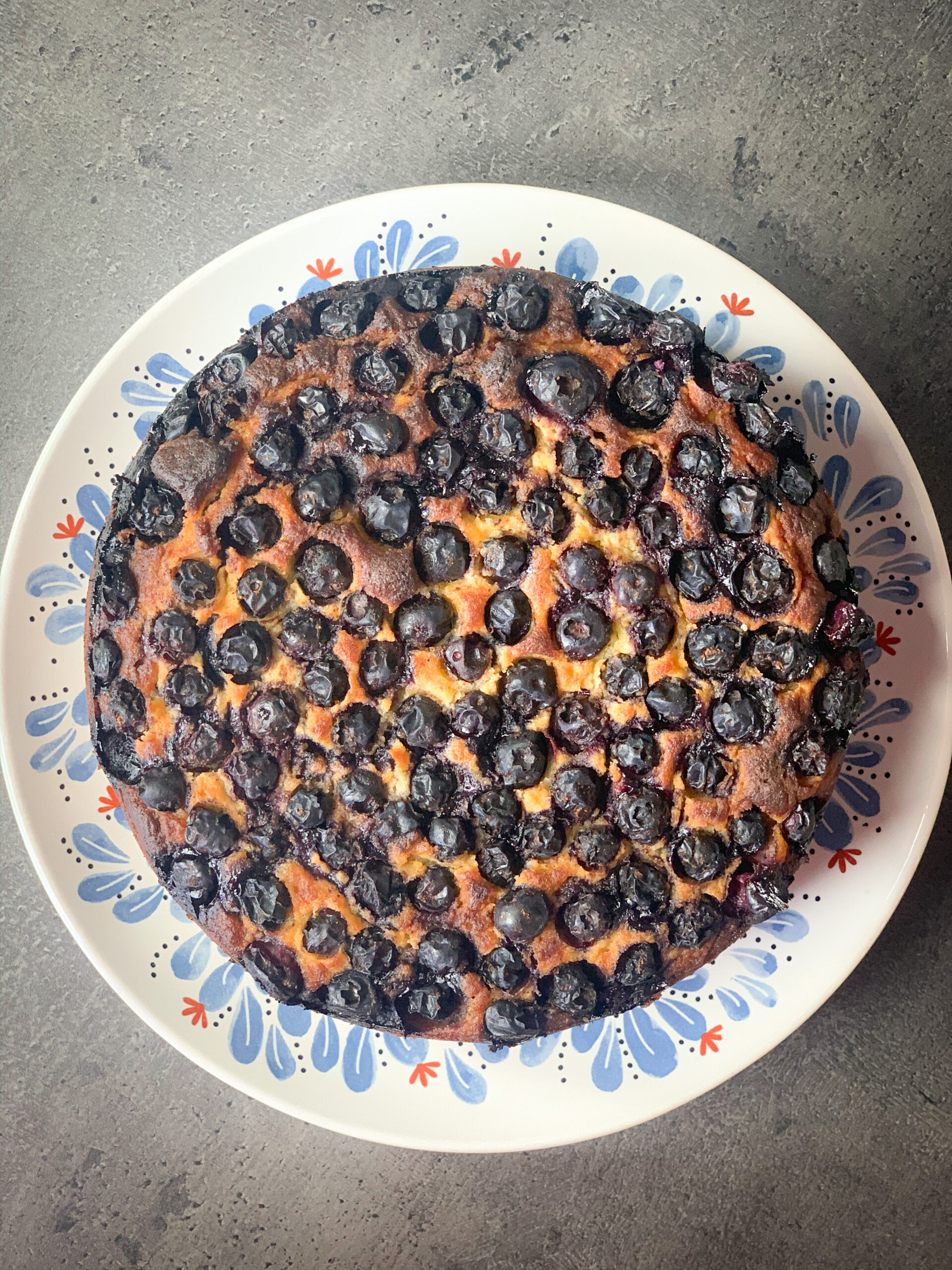 Picture of a whole keto blueberry pie on a plate
