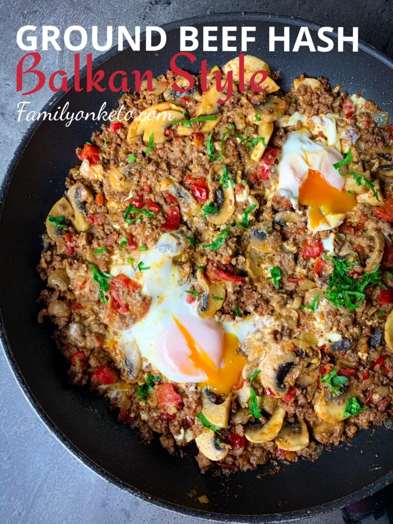 Ground beef hash in Balkan style with peppers, feta cheese and eggs in one skillet.