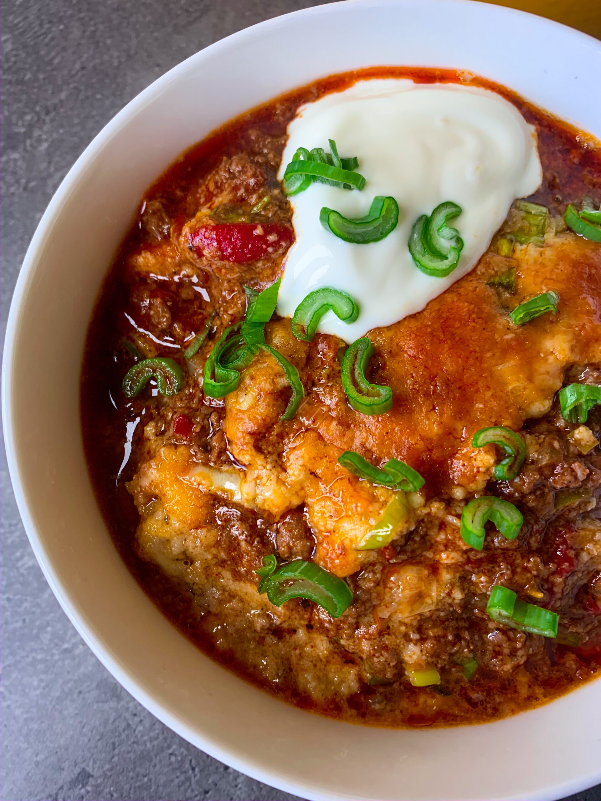 Low carb chili con carne with cheese crust in a bowl