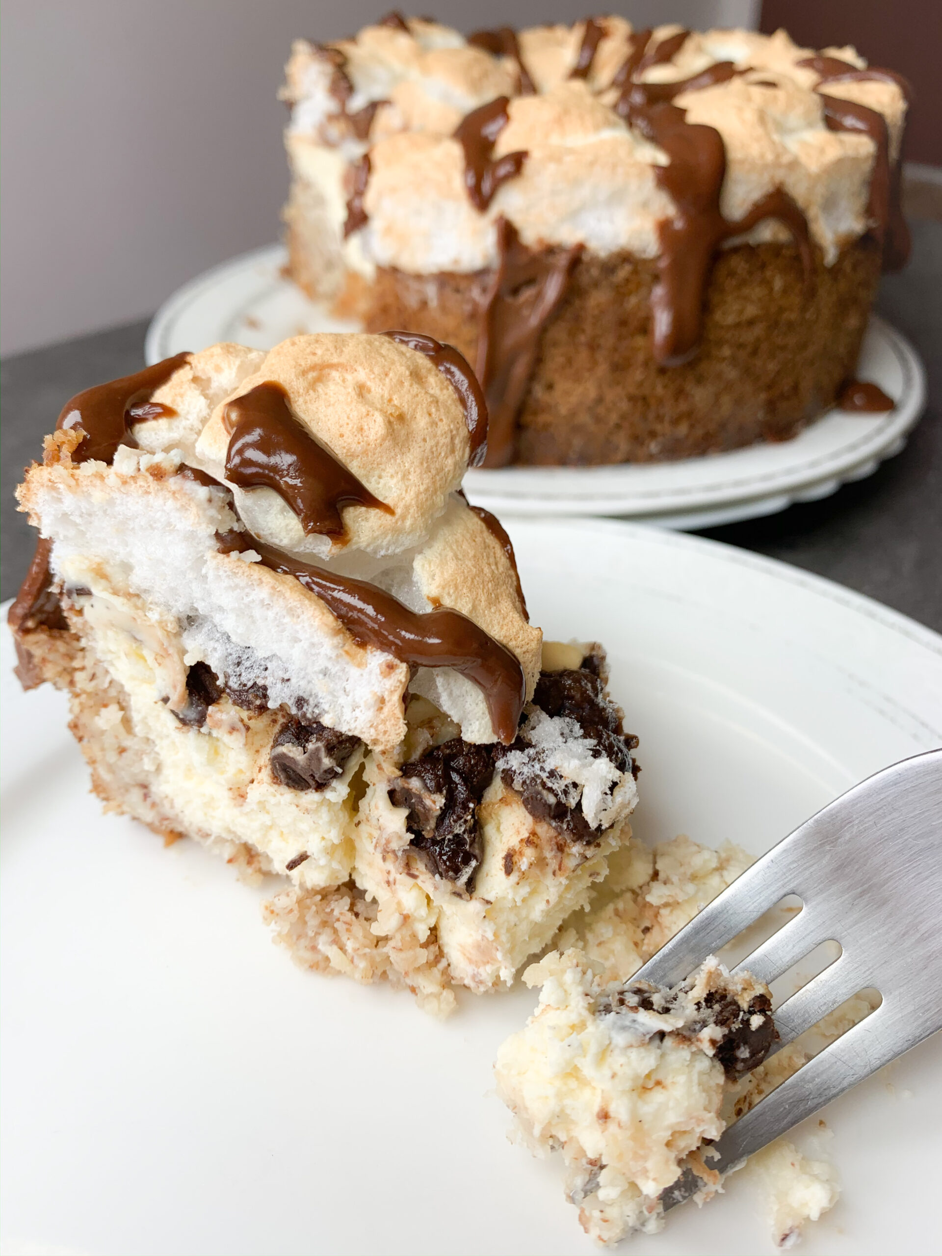 Picture of slice of low carb meringue cheesecake with chocolate that looks like S'mores cheesecake