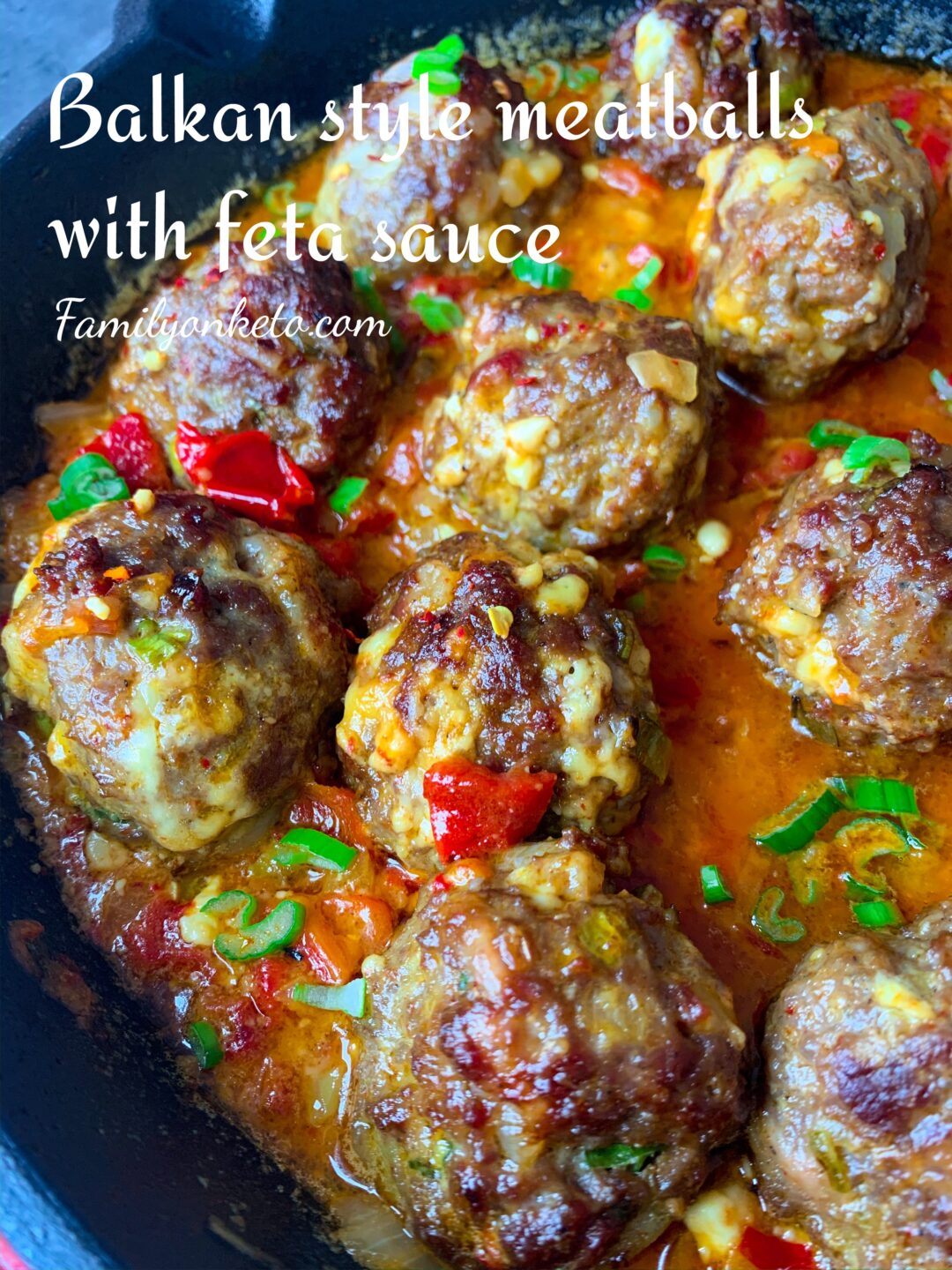 Picture of Balkan style meatballs with feta cheese sauce. Delicious keto meatballs recipe.