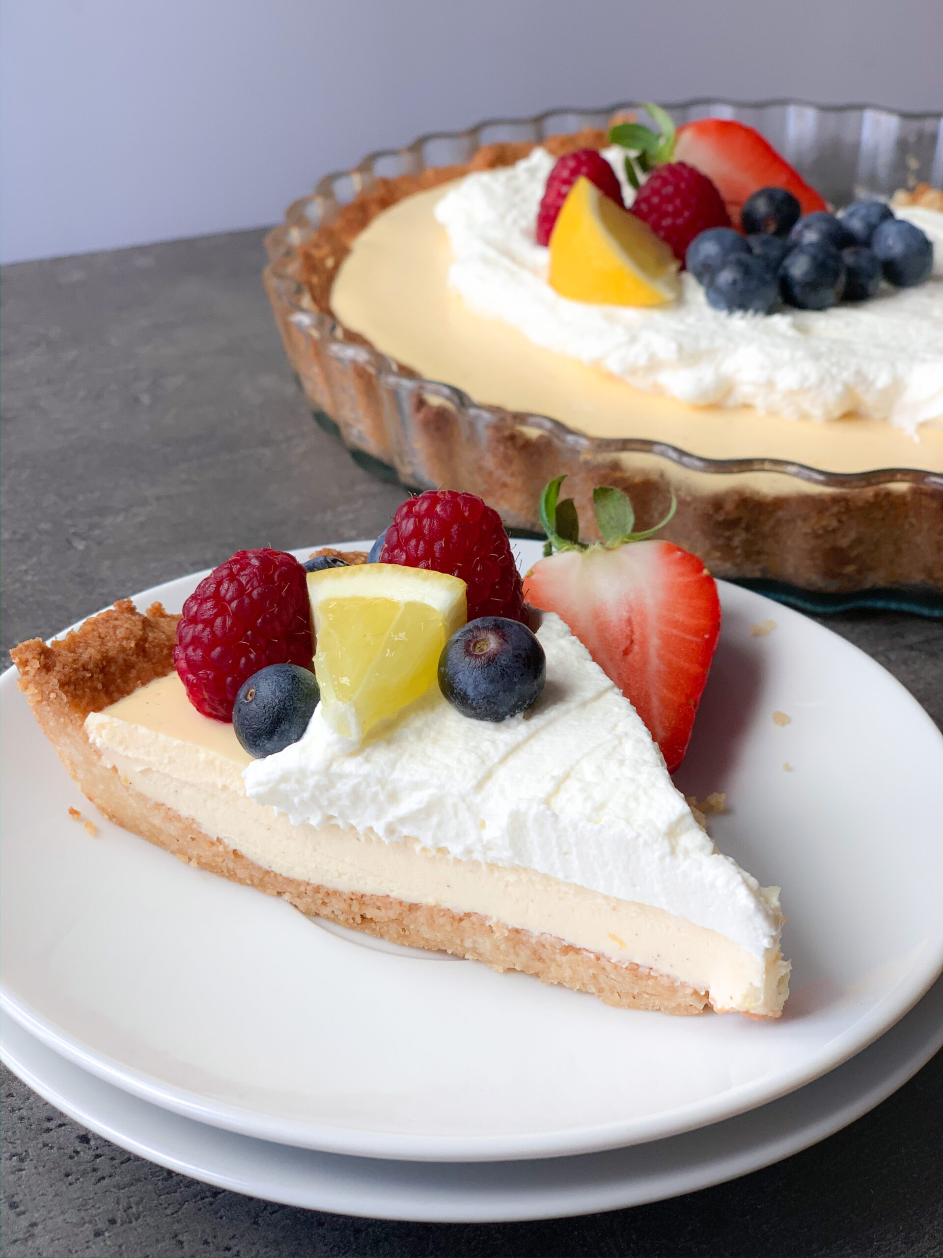 Picture of keto lemon cream pie with topping and berries