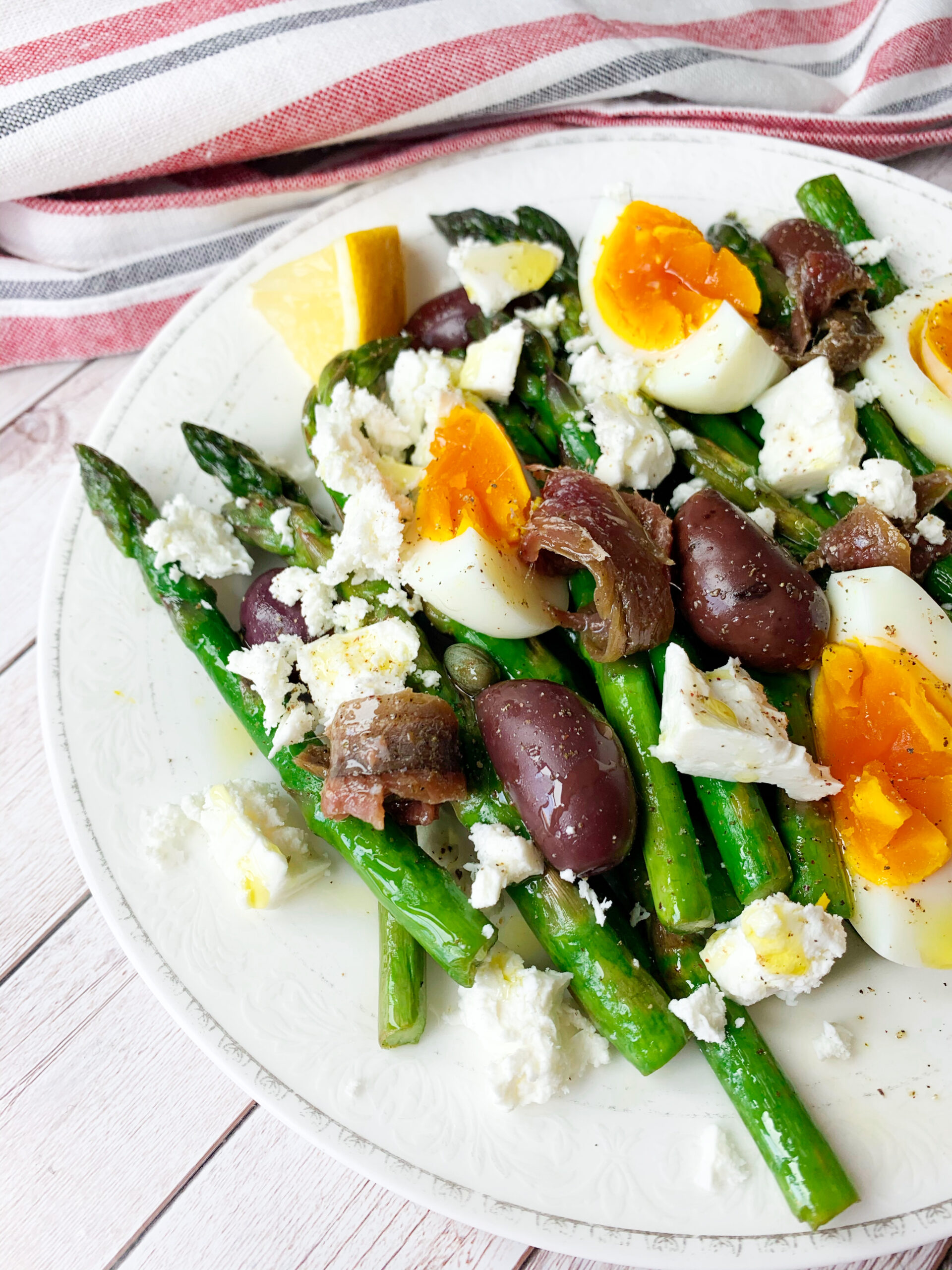 Photo of keto salad with asparagus and eggs with anchovies, capers and olives