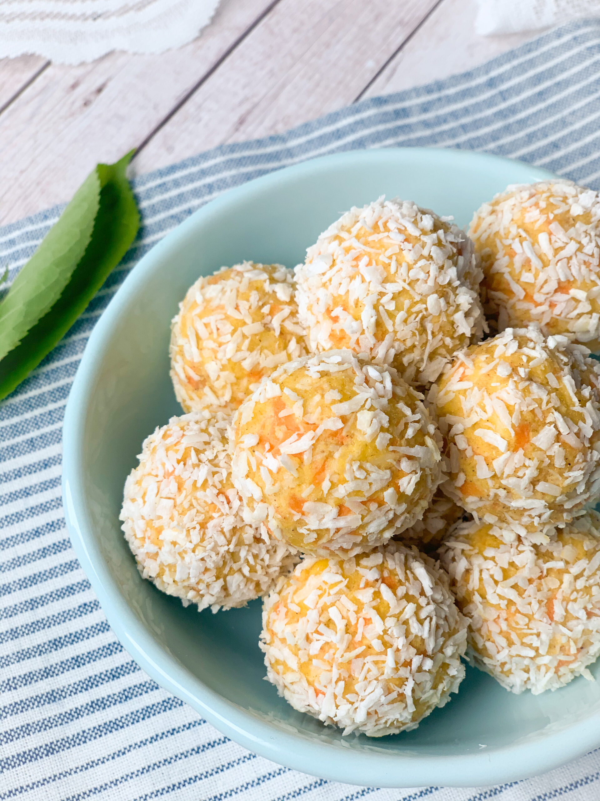 Picture of no bake keto energy balls with carrot, cream cheese and coconut or carrot cheesecake energy balls