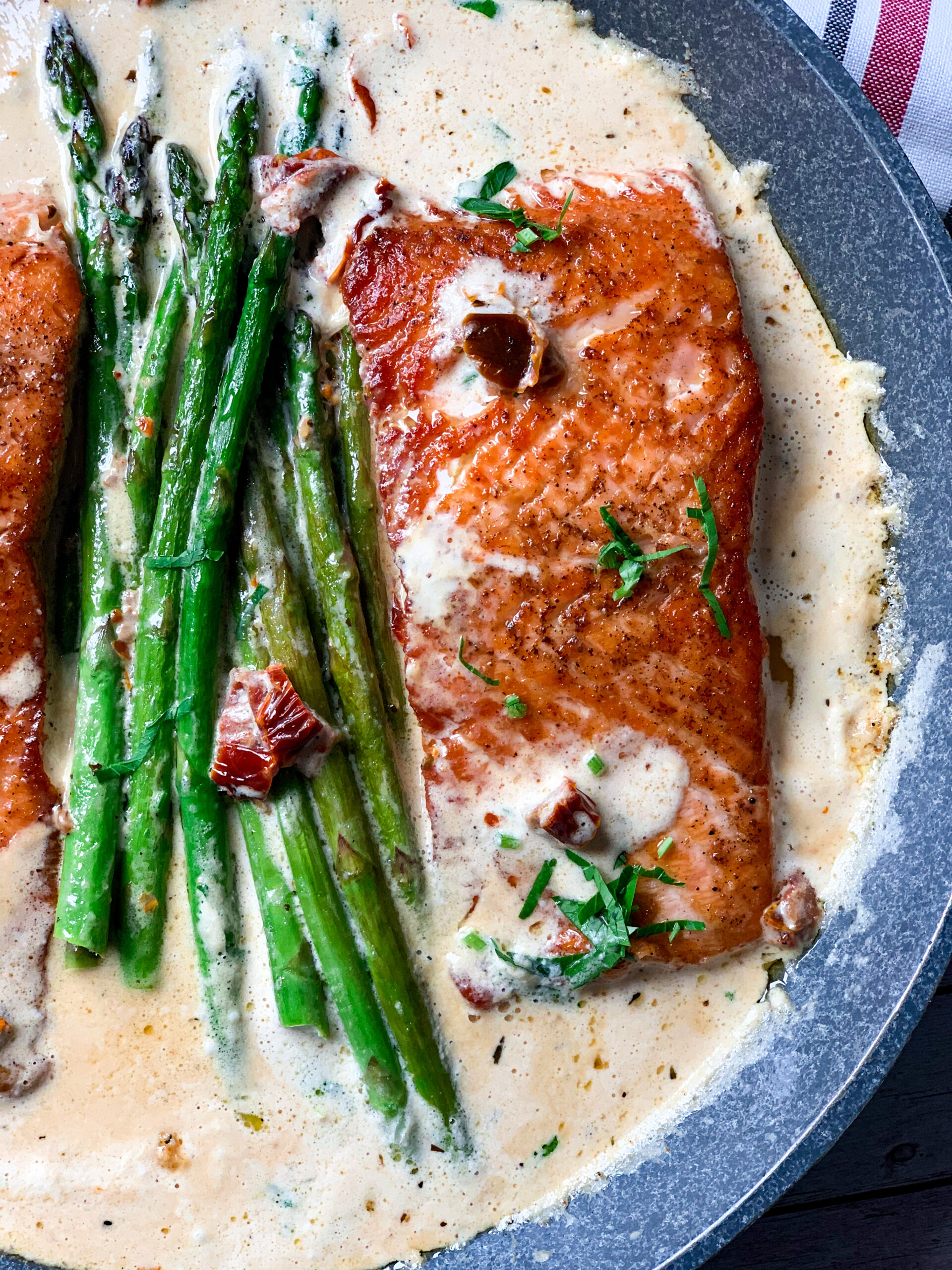 Picture of low carb salmon with creamy Tuscan sauce with garlic and butter and asparagus