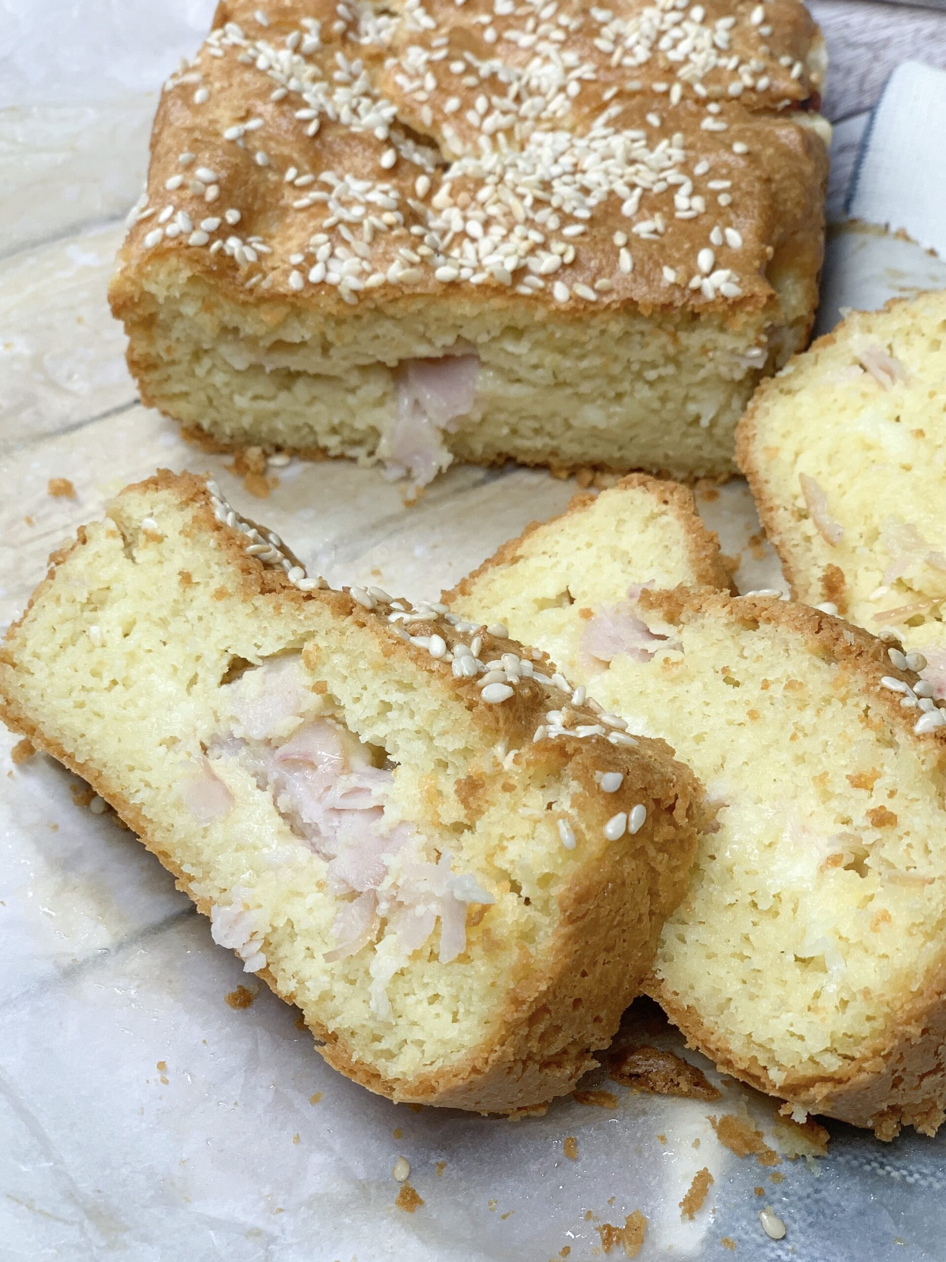 Photo of low carb almond bread with ham and cheese cut in slices