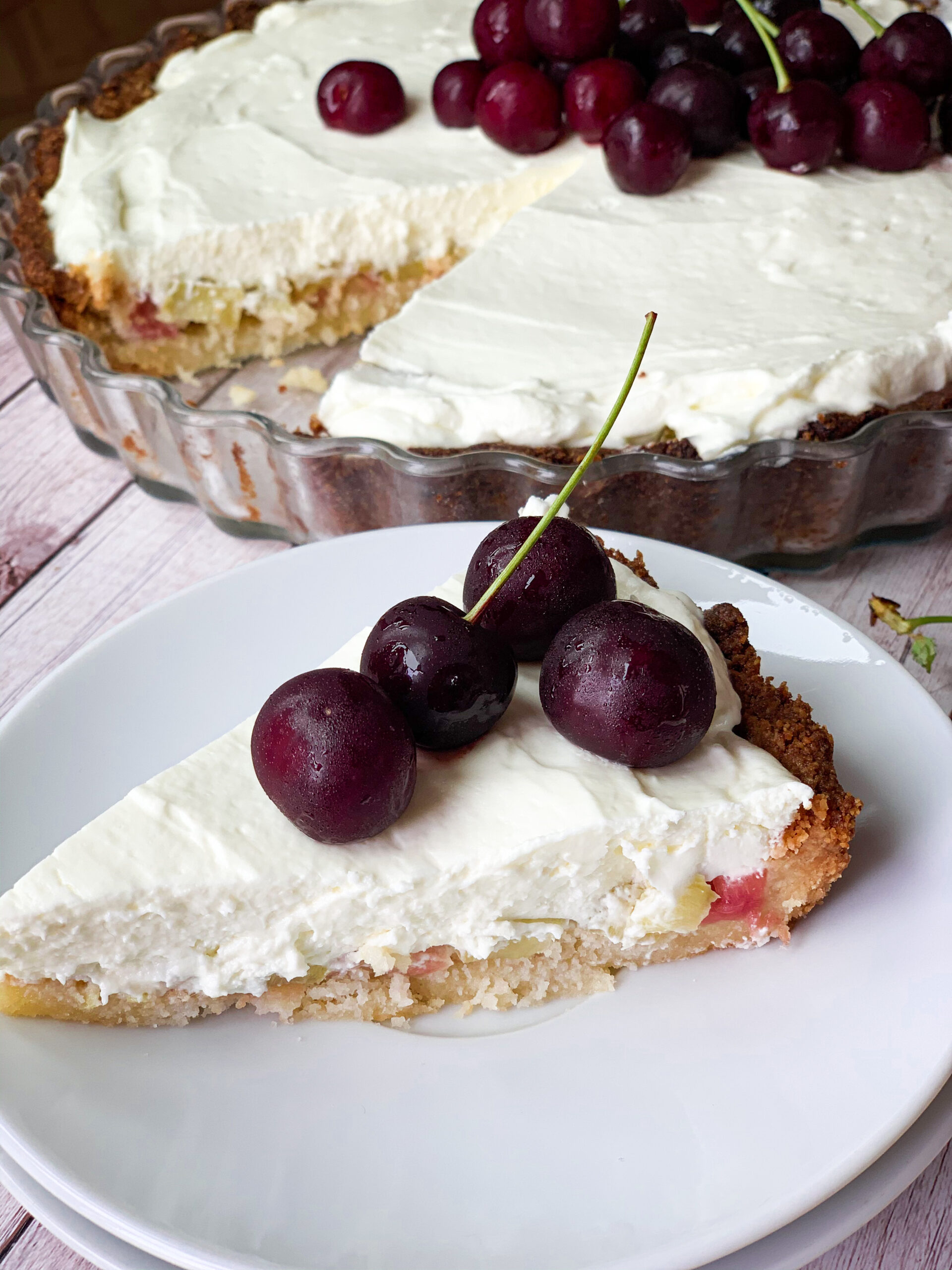Low carb rhubarb pie with cheesecake topping and tart cherries