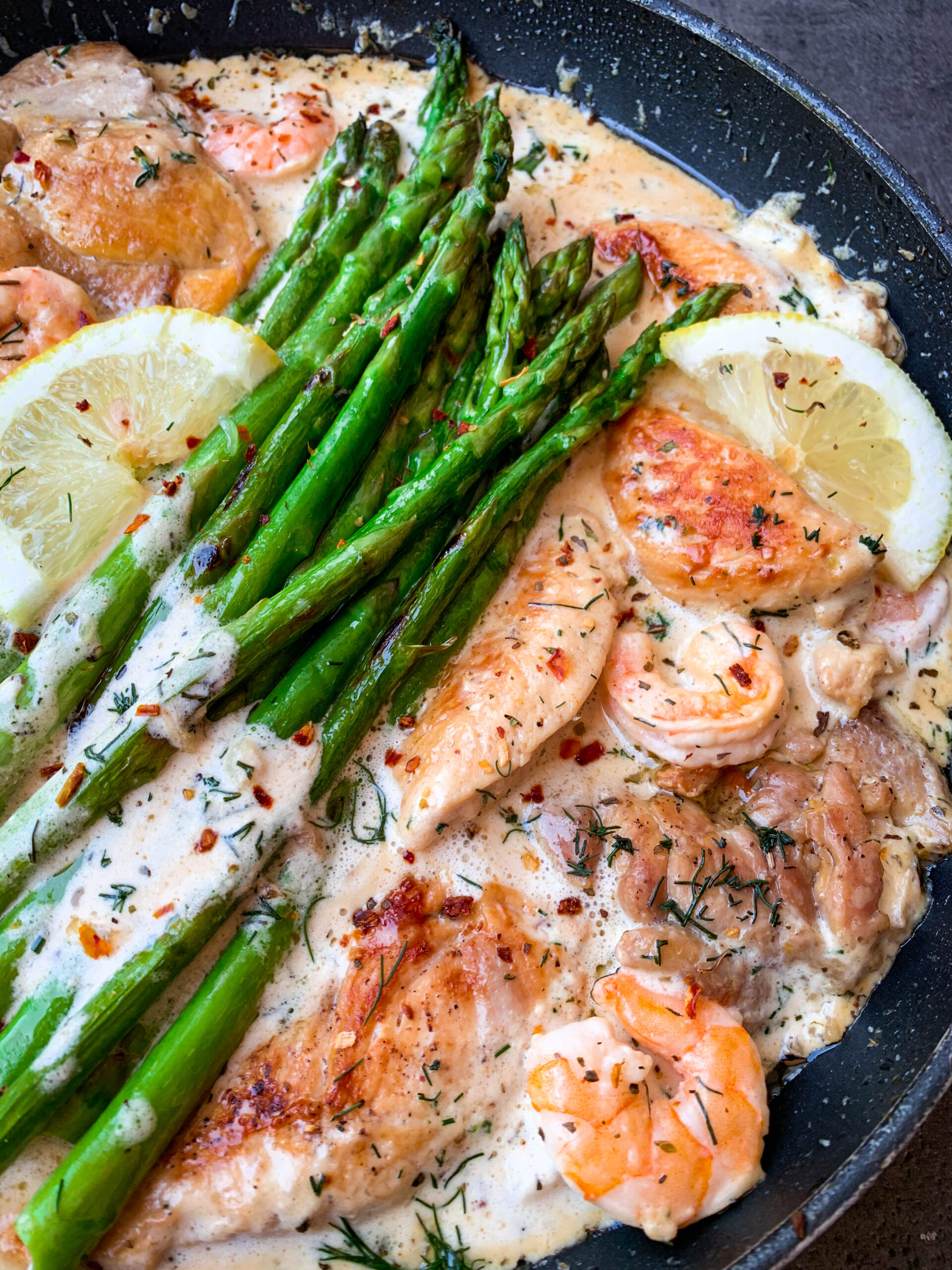 Picture of chicken with lemon cream sauce, shrimps, asparagus and dill