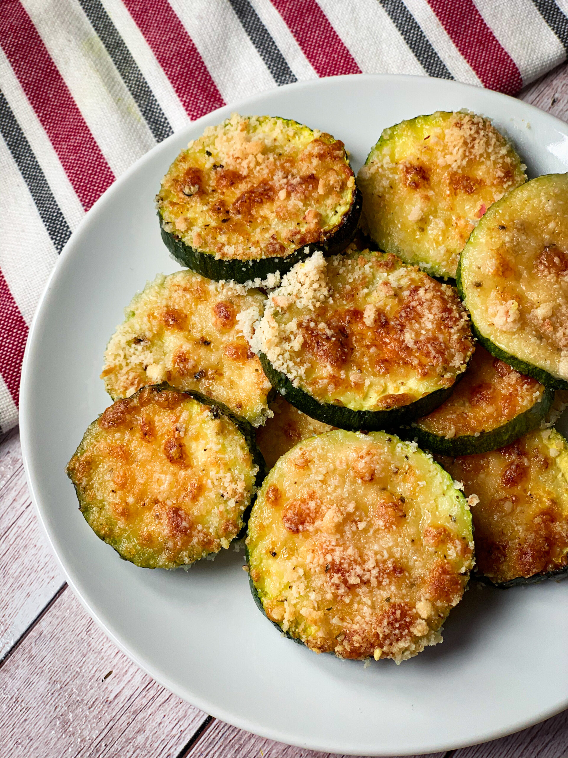 Picture of a plate with keto baked zucchini side dish with cheese and almond