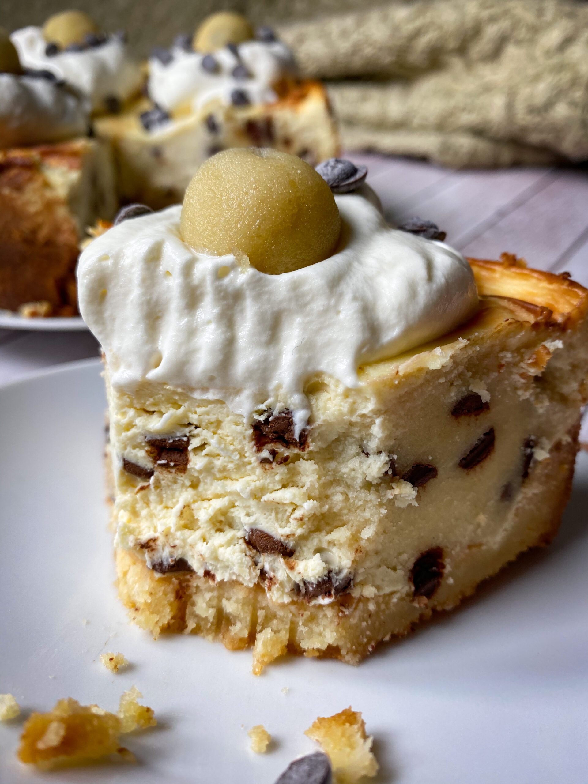 Picture of a slice of keto cheesecake with edible keto cookie dough
