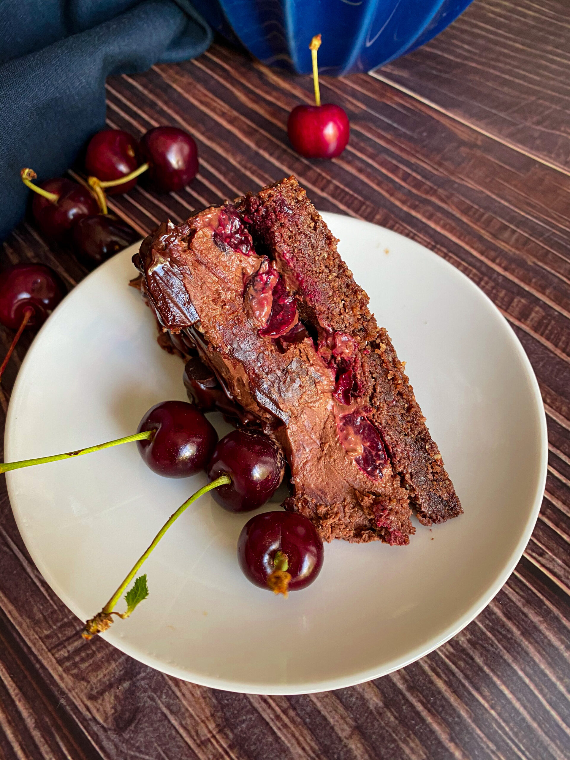 Picture of a slice of keto cherry chocolate cheesecake