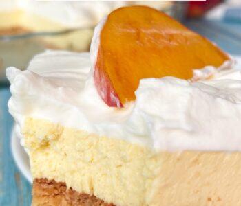 Slice of keto peach cream pie with cream and a slice of peach on top
