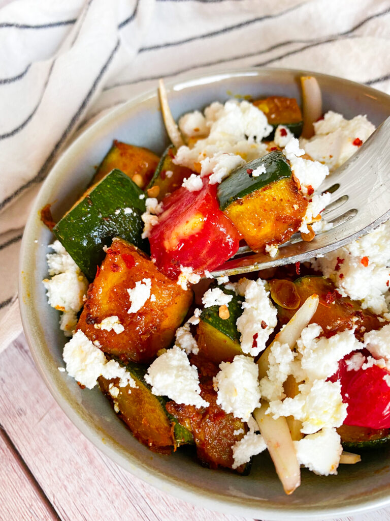 Picture of low carb zucchini salad with feta cheese, tomato and onion